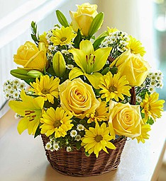 Yellow lilies with yellow gerberas Yellow roses in a basket