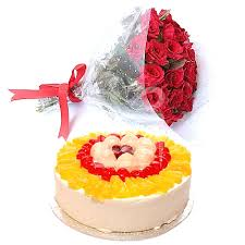 1 Kg Fruit Cake+ 12 red roses Bouquet
