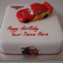 2 Kg black forest Toy Car on top of Cake