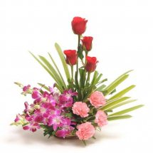 4 Red roses 4 Pink carnations 2 orchids Basket