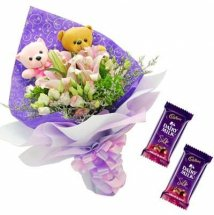 2 Teddies in a bouquet with 2 Silk Chocolates