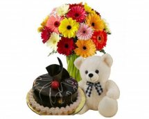 12 Gerberas bouquet wth 1/2 Kg chocolate cake Teddy 6 inches