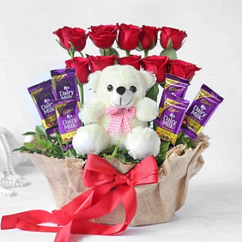 6 dairy milk chocolates with 10 Red Rose Teddy in the same basket