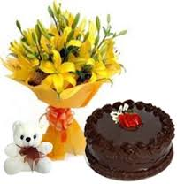 Yellow lilies bouquet with 6 inches Teddy and 1/2 Kg dark chocolate cake