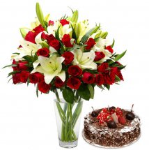 Red roses white lilies in a Vase with 1/2 Kg black forest cake