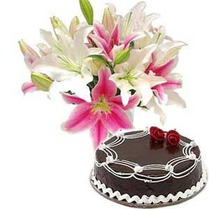 Half Kg Chocolate Cake with a bouquet of pink and white lilies