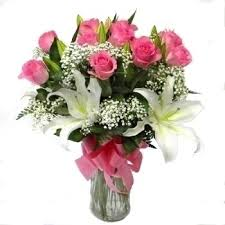12 pink Roses and white lilies in Vase