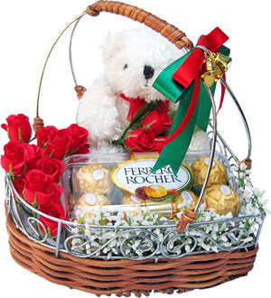 Teddy 16 ferrero Rochers and 12 red roses all in a basket