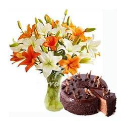 Orange and White Lilies bouquet with 1/2 Kg Dark chocolate cake
