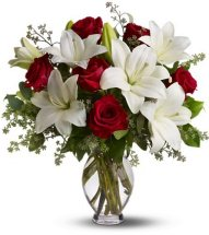 Red roses white lilies in a Vase