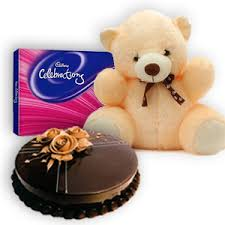 6 inches Teddy with 1/2 Kg chocolate cake and a celebration pack