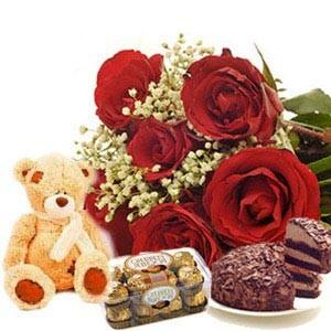 6 Red roses bouquet with 6 inches Teddy 1/2 Kg chocolate cake and 16 Ferrero rocher chocolates