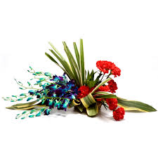 4 blue orchids 6 red carnations basket