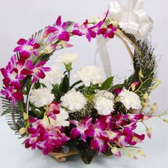4 purple orchids 4 white Carnations in a handle basket