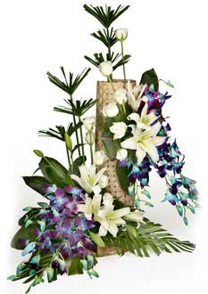 Blue Orchids+ white lilies white carnations with mat in Basket