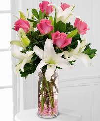 6 pink roses 3 White Lilies in a Vase