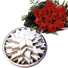 1/2 Kg. kaju Katli and 12 red roses bouquet