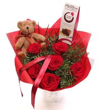 6 Red roses and Teddy 6 inches each in same basket with red wrapping