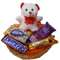 6 inch Teddy in a basket of chocolates